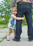 Little girl holding the feet of parents Royalty Free Stock Photos