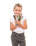 Little girl holding a few colorful pencils on white Royalty Free Stock Image