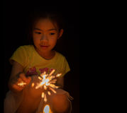 Little girl holding firewors stock photography