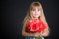 Little Girl Holding Flower Stock Photo