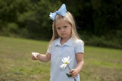 Little Girl Holding a Flower Royalty Free Stock Photography