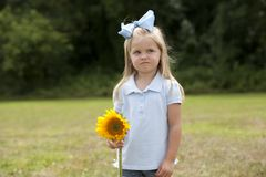 Little Girl Holding a Flower Royalty Free Stock Images