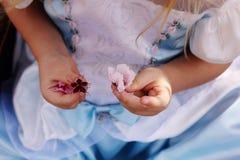 Little Girl Holding Flower Stock Photos
