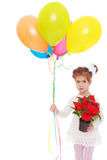 Little girl holding a flower pot and balloons Stock Image