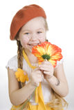 Little girl holding a flower and smile. Stock Image