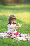 Little girl holding flowers Royalty Free Stock Images