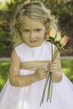 Little Girl Holding Flowers Stock Photos