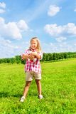 Little girl holding football ball Royalty Free Stock Image