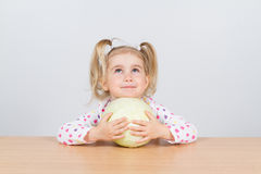 Little girl holding forks of cabbage. Royalty Free Stock Image