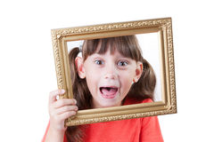 Little girl holding a frame for pictures Royalty Free Stock Image