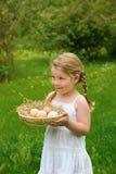 Little girl holding fresh eggs Stock Image