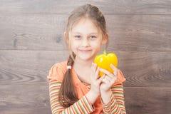 Little girl holding a fresh sweet vegetable Stock Image
