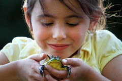 Little Girl Holding Frog Stock Images