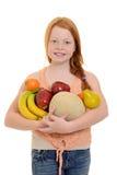 Little girl holding fruit Stock Photo