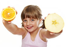 Little girl holding fruits Stock Images