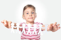 Little girl holding garland of paper little people Stock Photos