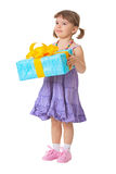 Little girl holding a gift - birthday Stock Photo