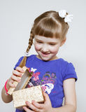 Little girl holding gift box royalty free stock photography