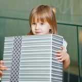 Little girl holding a gift Royalty Free Stock Photos