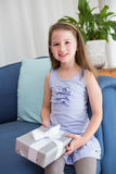 Little girl holding a gift Stock Photography