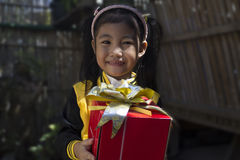A little girl holding a gift. Royalty Free Stock Photos
