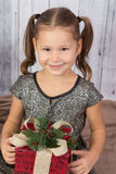 Little Girl Holding a Gift Stock Images
