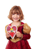 Little girl holding gingerbread heart Stock Photo