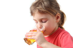 Little girl holding glass with juice for one hand Royalty Free Stock Photography