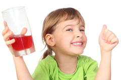 Little girl holding glass with juice and smiling Royalty Free Stock Image