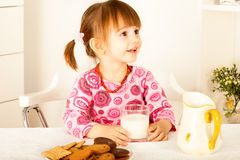 Little girl  holding glass of milk Royalty Free Stock Photography
