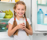 Little girl holding a glass of milk Stock Image