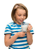Little girl is holding a glass with milk Royalty Free Stock Images
