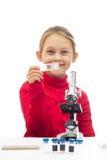 Little girl holding a glass slide Stock Photo