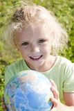 Little girl holding globe Royalty Free Stock Photos