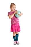 Little girl holding a globe. Stock Photo