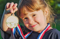 Little gold medalist Stock Images