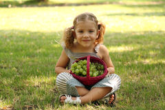 Little girl holding with grape Royalty Free Stock Photo