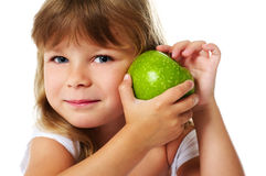 Little girl holding green apple Stock Image