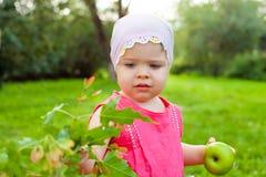 Little girl holding green apple Stock Image
