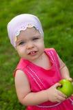 Little girl holding green apple Royalty Free Stock Image