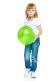 Little girl holding a green ball Stock Photography