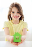 Little girl holding green paper house Royalty Free Stock Photography