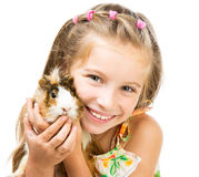 Little girl holding a guinea pig Stock Images
