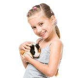 Little girl holding a guinea pig Royalty Free Stock Images
