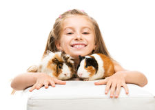 Little girl holding a guinea pig Stock Image