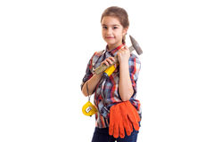 Little girl holding hammer, screwdriver and roulette Royalty Free Stock Image