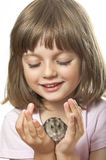 Little girl holding hamster Royalty Free Stock Photos