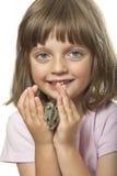 Little girl holding hamster Royalty Free Stock Image