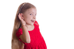Little girl holding hand on ear Royalty Free Stock Photos