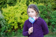 Girl. Little girl holding hand made heart on blurred background Stock Photography